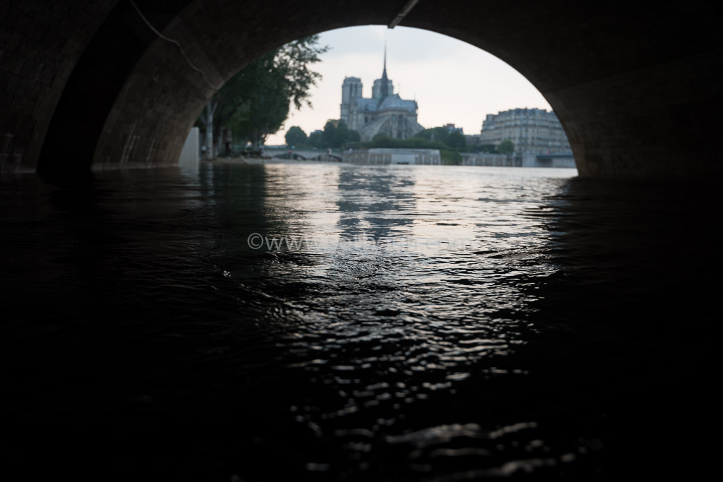 Paris . Flooding . The Seine river under the quay de la Tournelle , in the distance Notre dame cathedral